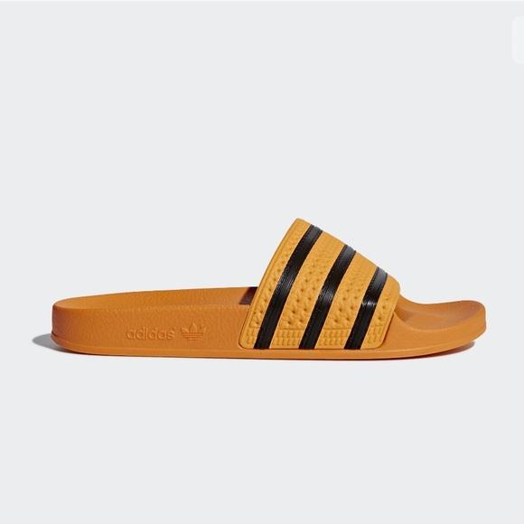 2343128bf50f5e ADIDAS Adilette Yellow Gold Black Slide Sandals 8